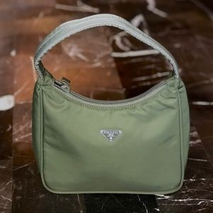 Prada Vela new with authenticity cards mini